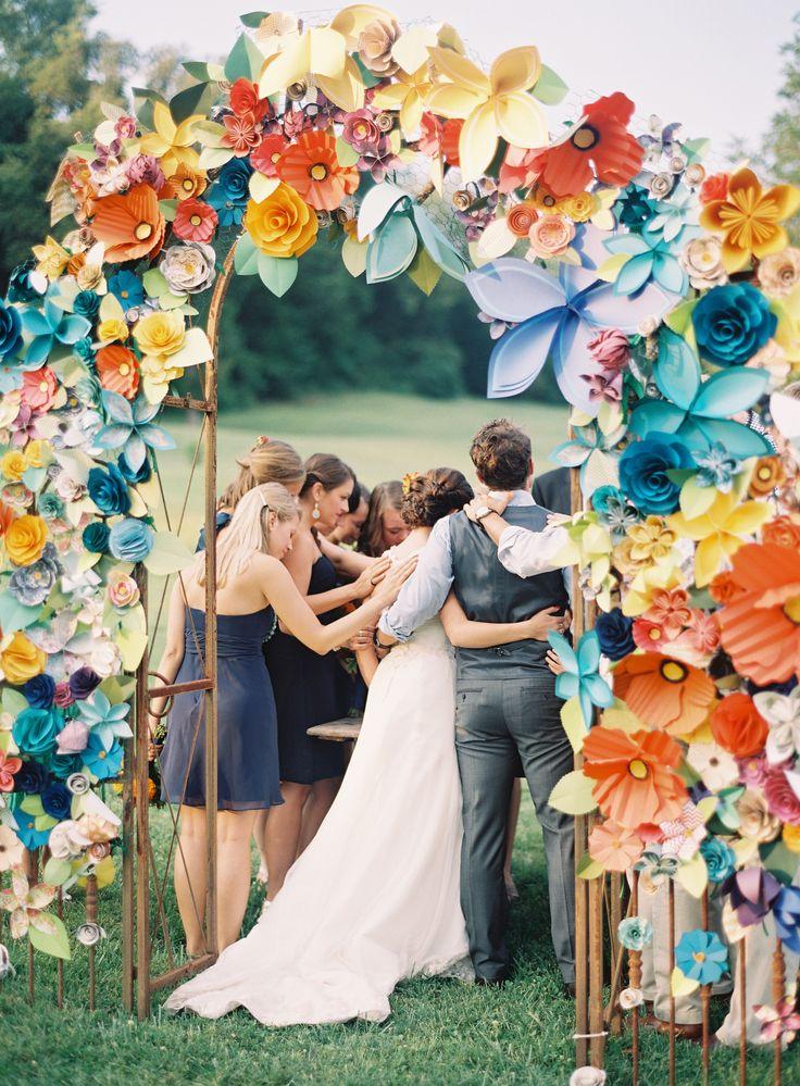 Paper flower arch for wedding ceremony. #DIY