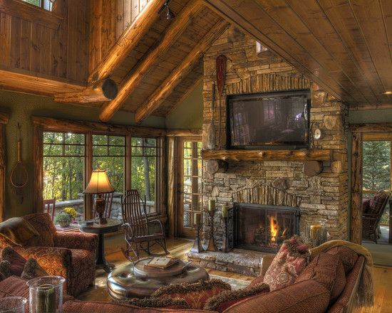 Perfect cabin in the woods with open timber design, stacked stone fireplace with flat screen above and french doors out to screened porch and open terrace. Who wouldn't want to spend their weekends here?