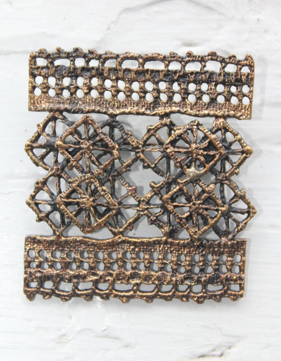 "Vintage bronze ""Pitsi"" / ""Lace"" brooch, by Pentti Sarpaneva for Turun Hopea Finland. Sarpaneva got inspiration for this design from traditional lace making in Finland, specifically from Rauma area - which is known for its traditional lace making. City of Rauma holds an annual ""Lace week"", where you are able to find lacemakers and beautiful hand made lace products for sale."