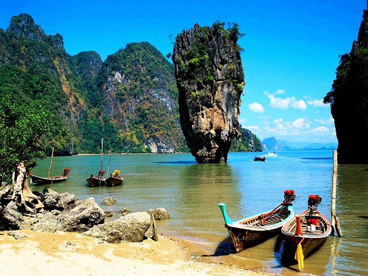 Khao Phing Kan, Phuket,Thailand. This is the real deal--too many photo shopped pix circulating the internet with various structures atop the natural phenomena.