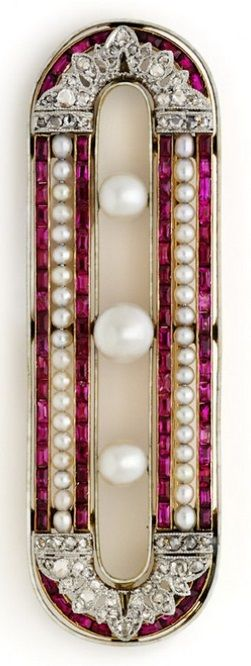 An Art Deco Ruby, Natural Pearl, Diamond and Enamel Brooch, by Chaumet, France, Circa 1920. An extremely fine quality French cut ruby, natural pearl, diamond and white enamel brooch set in 18ct yellow gold and platinum. #Chaumet #ArtDeco #brooch