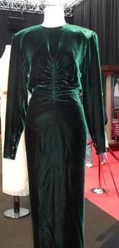 Designed by Victor Edelstein 1985 . Bottle green velvet gown trimmed with three buttons on the back and each cuff. $32,200.00 Purchased by a woman from Florida. Sold March 2013 by Kerry Taylor auctions £24,000