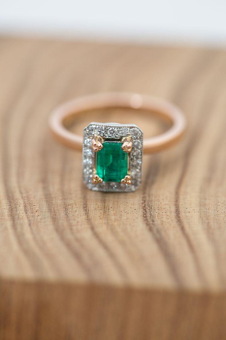 Platinum and 750 rose gold engagement ring. Emerald centre stone. 1pt diamonds set around the emerald. Features include the millgrain edge, three pronged claws.#Custom #Design #Luxury #Engagement #Bridal #Wedding #Jewellery #MasterJeweller #TerryCockrem #RoseandCrownJewellers #Platinum #Gold #Diamond #Sapphire #Emerald