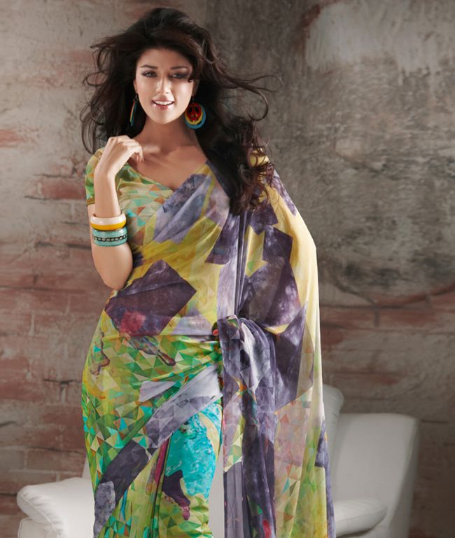 """If you are a true fashion cultivator of ethnic desires, this vogue collection of sarees from """"Brijraj"""" will help you to justify the needs of your insatiable soul. Perfectly accentuating your feminine grace with ease, this range liberates the aesthetics of Indian tradition through the diversified designs in grace and sophistication. Unleash your shopaholic attitude through this collection with fashionandyou.com.BRAND: BrijrajCATEGORY: Printed Saree with Unstitched…"""