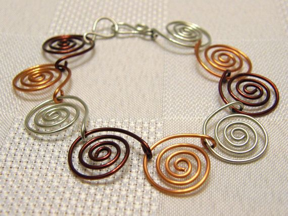 Spiral Link Wire Bracelet. I have lots of colors of wire to do this one - yes