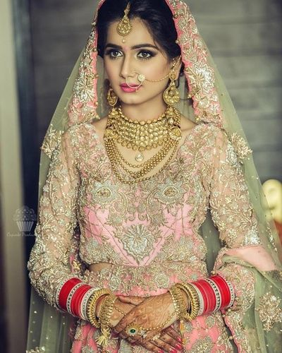 Bride- Portraits - Bride in a Light Pink Embroidered Lehenga with Gold and Polki Jewelry | WedMeGood #wedmegood #indianbride #indianwedding #bridal #bridalportriat #pink #gold