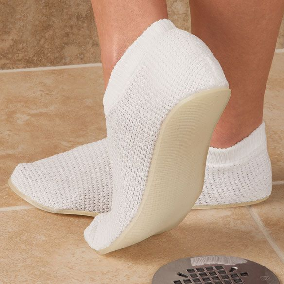 Non-slip shower slippers feature latex-free rubberized soles to grip wet surfaces. Nylon upper on shower slippers stretches for a comfortable fit and lets water through to keep feet clean. S-XL. Machine washable.