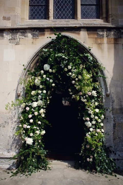 Perfect ceremony inspiration - ancient churches and floral archways.
