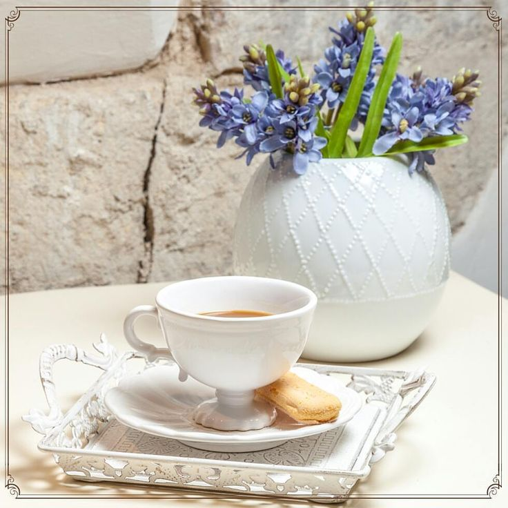 Hyacinths, Blue spots on ivory vases. Delicious butterscotch biscuits and wonderful cups
