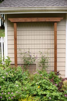 DIY Garden Trellis out of pressure treated wood and cattle fencing.