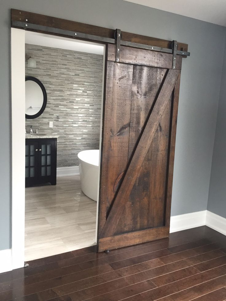 This is the PERFECT sliding barn door! Nice wall colour too.  #barndoordesigns #bathroombarndoor Barn Door