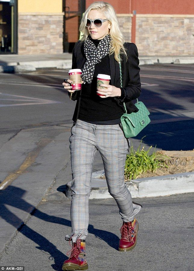 Stylish star: Gwen carried two Starbucks hot drinks in hand and dressed sharply