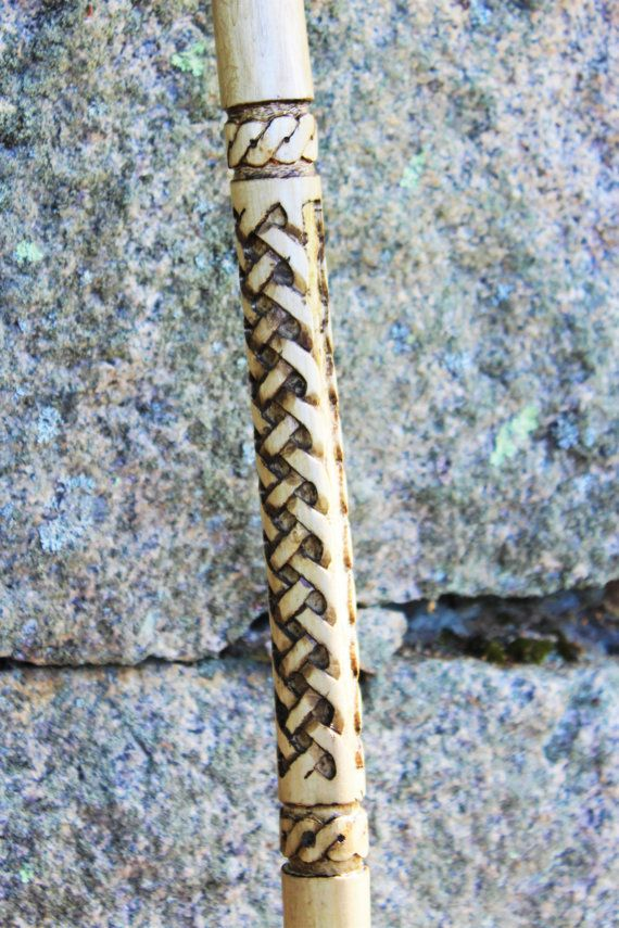 Hand carved, walking stick with a celtic braid design on the body of the stick and a serpentine design above and below the braid. This sturdy 60 tall, staff is made from ash (a hardwood). I apply a tawny stain and then hand sand to reveal the design when the white wood shows through. It is then clear coated to a lustrous finish. It has a green paracord handgrip and wrist strap. Contact us for a custom order or personalization of a stock item.