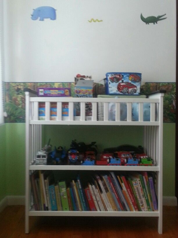 Changing table repurposed as book and toy storage shelves.