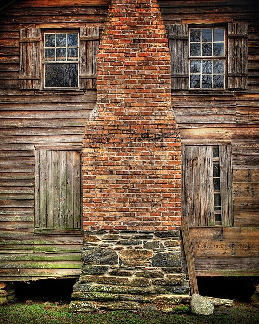 Weathered historic building and brick stone fireplace for Brick cabin