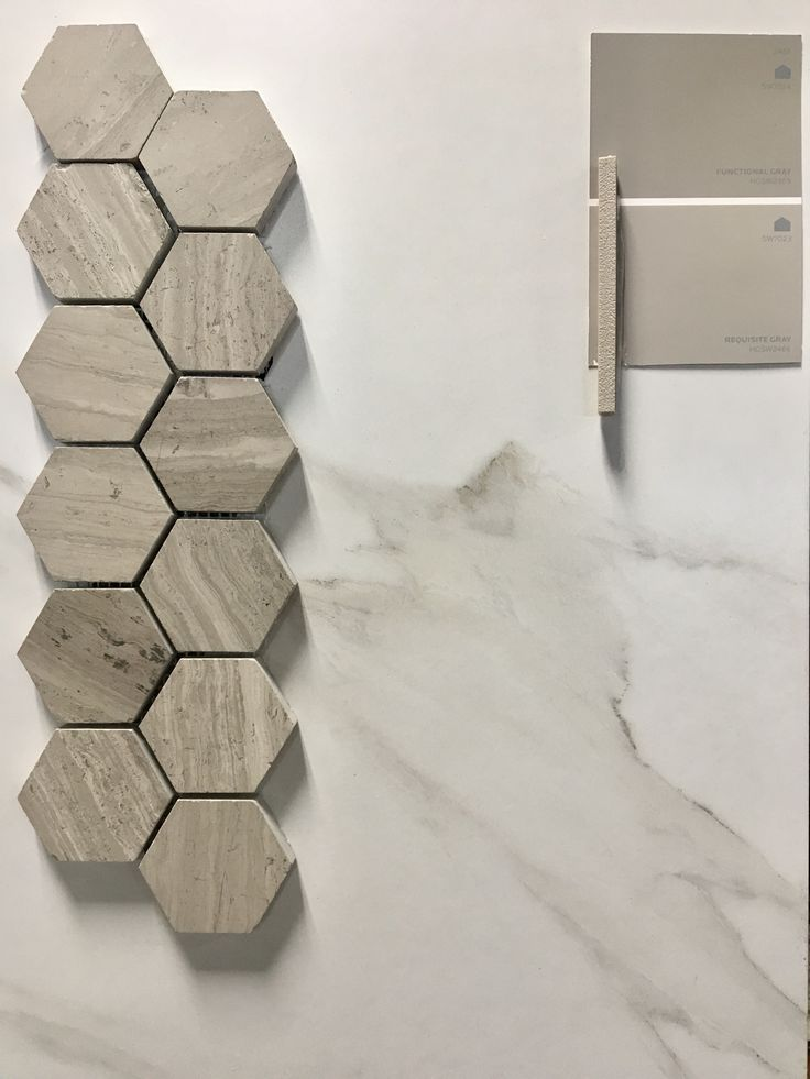 """For all the marble lovers out there that love marble, but don't want the maintenance of a natural stone... this week's pretty pick of the week is the most perfect alternative! Shown above is our IN STOCK 12x24 Porcelain Calacatta tiles that we paired with a Greige 2"""" hex for a shower pan! Carrying the contrasting colors up into the wall, Sherwin Williams Requisite Gray and Furnctional Gray pair so beautifully with this tile combo it looks like it was made just for it!"""