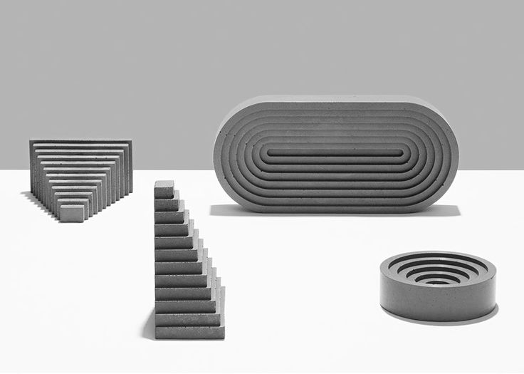 Concrete tabletop accessories modelled on the shapes of ancient Greek and Mayan architecture