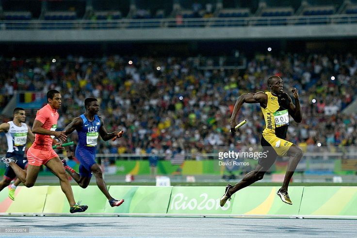 Usain Bolt of Jamaica competes on his way to winning ahead of Aska Cambridge of…