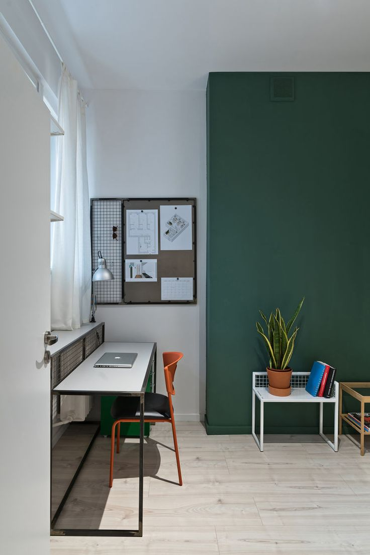 Student apartment living room - Orange Ikea Chair Green Accent Wall And Custom Furniture In Polish Apartment