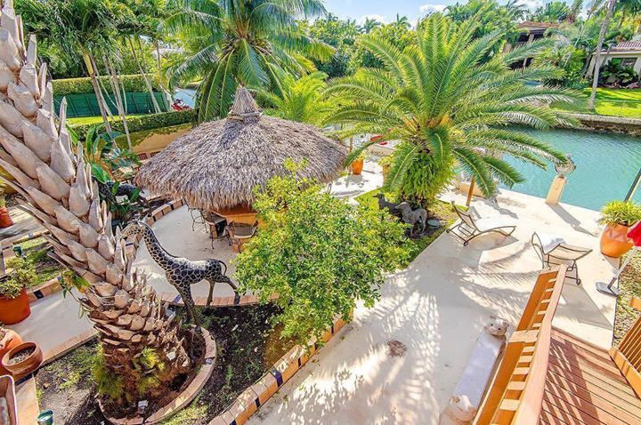 If you're looking for your very own tropical oasis in Miami Beach look no further! This unique waterfront smart home on 9000 sq ft lot has 4 bedrooms / 4 bathrooms with Efficiency. Located in Biscayne Point home features boat dock/lift on canal with ocean access. Protecting your home is a breeze with wireless hurricane shutters and windows. Enjoy entertaining or relaxing on the huge roof-top terrace measuring 27x46 or tropical backyard with tiki bar wood burning oven and much more to enjoy…