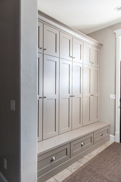 Love the color of this storage in the mudroom.