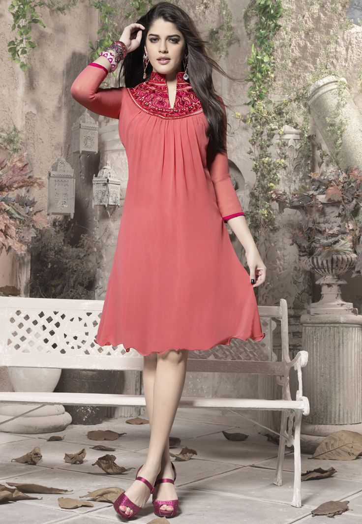 A bewitching Pink Color 60 Gm Georgette Fabric Kurti featuring a gorgeous detailed paisley embroidery on the yoke