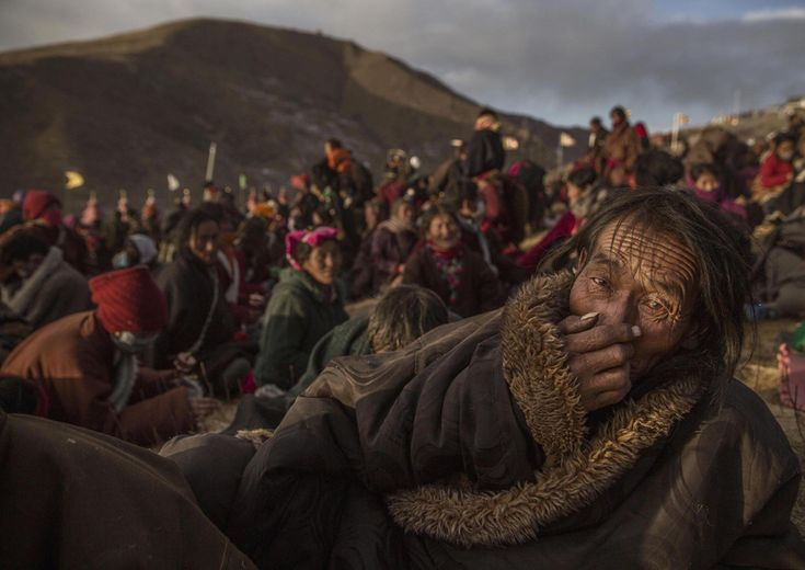 """Daily Life, second prize winner, stories. From """"Bliss Dharma Assembly,"""" Tibetan Buddhist nomads listen during the annual Bliss Dharma Assembly in Sertar county on October 31, 2015. Winners of the 2016 World Press Photo Contest - The Atlantic"""