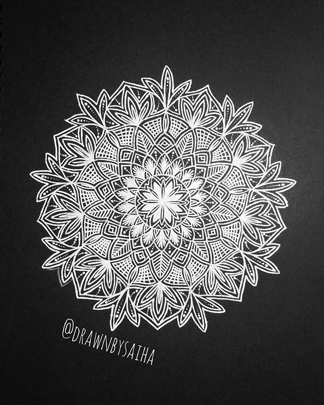 its been a looooong time since i've done a white on black mandala. felt good to have my hands on a white pen again