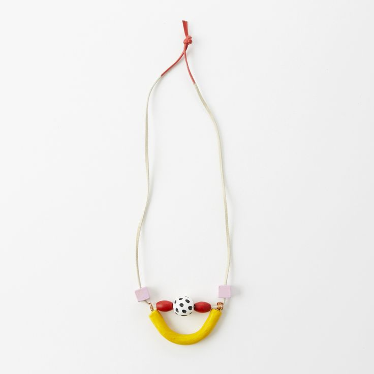 """<strong>This handmade necklace is the perfect statement piece made by Courtney Pilgrim from My Friend Court.</strong>  Hand painted wooden and handmade clay beads with 18"""" leather strap with color + brass accents."""