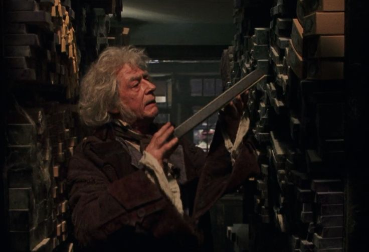 Garrick Ollivander (John Hurt) selecting potential wands for wizards and witches in Harry Potter and the Sorcerer's Stone (2001)
