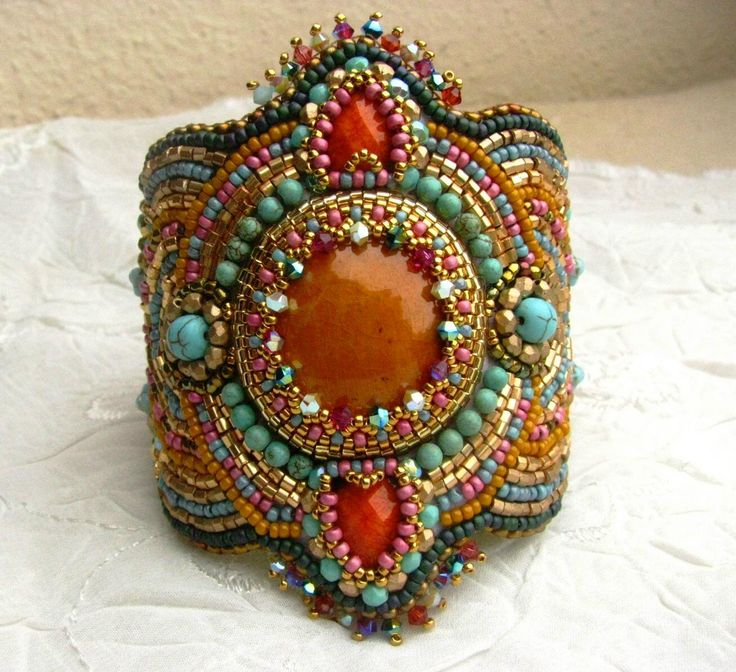 Bead Embroidered Bracelet - Bead embroidery art - OOAK - India - turquoise, orange, fuchsia, gold. $140.00, via Etsy.