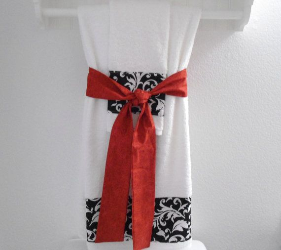 Elegant white and red bathroom bath and hand towel for Red and black bathroom accessories sets