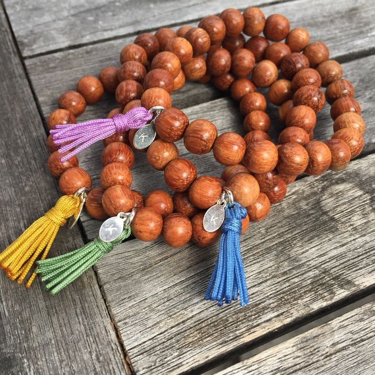 BAYONG WOOD TASSEL MALA BRACELETS These natural wooden beads are calming and soothing to the touch. Choose from four colours for our special handmade tassels; yellow (sun), green (earth), blue (water), pink/purple (love & magic).  http://www.karmaladesigns.bigcartel.com/