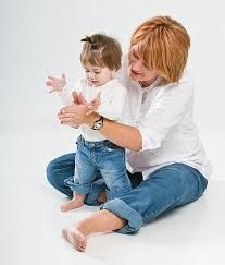 Teach your baby to imitate your actions, including clapping you hands, throwing kisses, and playing finger games such as pat-a-cake, peek-a-boo, and the itsy-bitsy-spider. Pragmatic development by using gestures to communicate.   http://library.missouristate.edu/meyer/crc/fingerplays.pdf   http://www.asha.org/public/speech/development/parent-stim-activities.htm