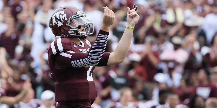 Johnny Manziel, Texas A&M star, celebrates after throwing a TD. Ranking first overall in the draft, everyone is wondering where he will go in the 2014 Draft.