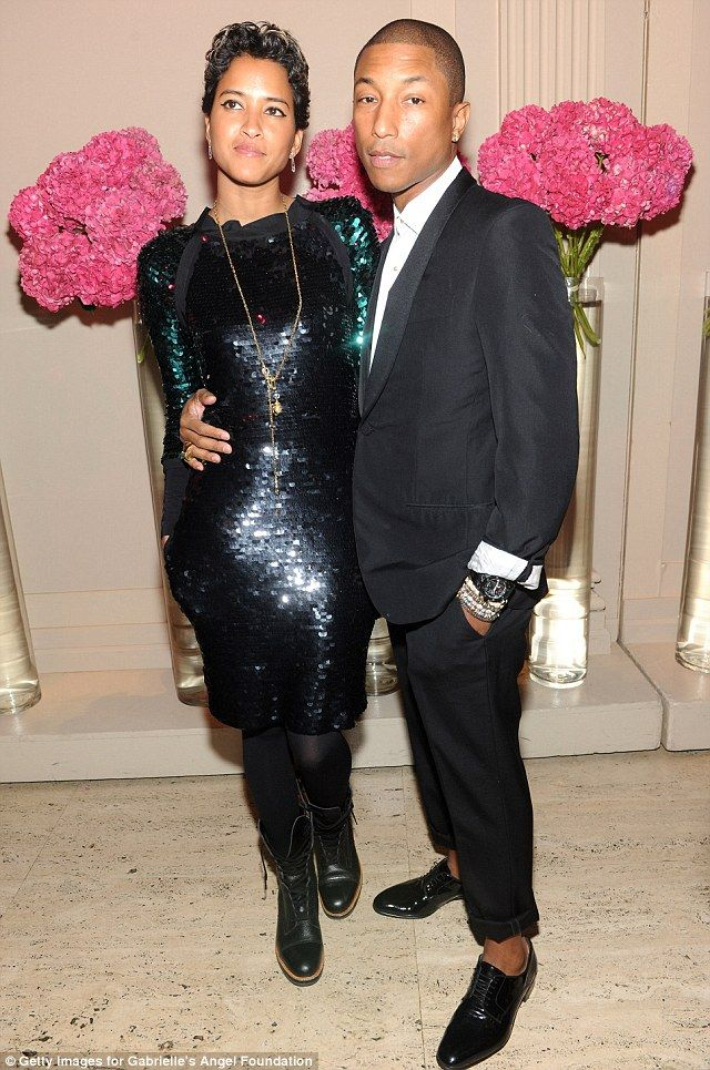 The trendiest newlyweds in town: Pharrell Williams and wife Helen Lasichanh make a glamorous arrival to the Angel Ball