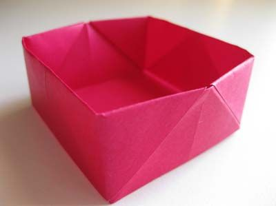 Easy Origami Box - Recycled some chevron gift wrap and just made this to store my paperclips at work! EASY and super cute!