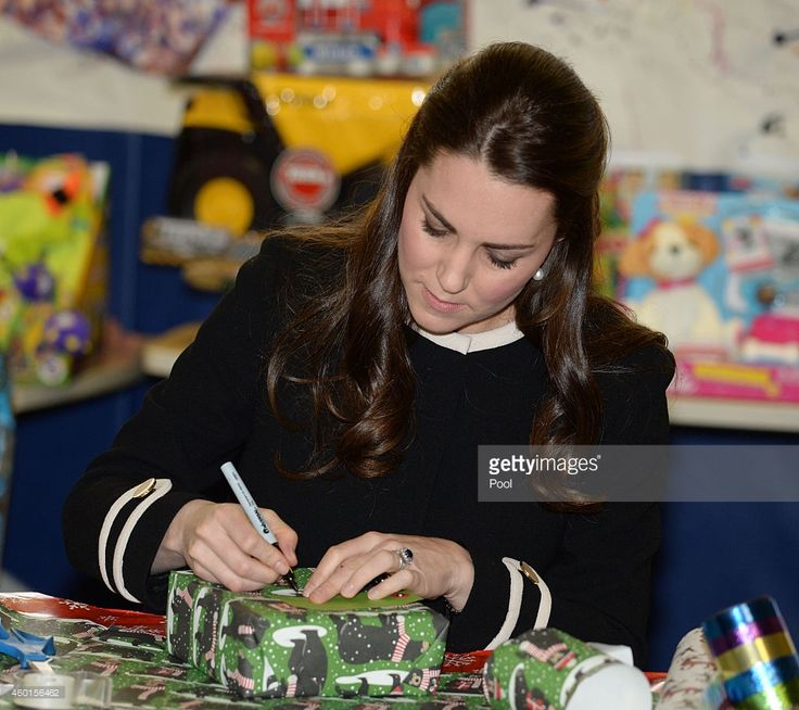 Catherine, Duchess of Cambridge, helps to wrap Christmas presents during a visit with Chirlane McCray, the first lady of New York, to the Northside Center for Child Development on December 8, 2014 in New York City. The royal couple are on an official three-day visit to New York with Prince William also due to meet President Barack Obama in Washington D.C today.  (Photo by Mark Stewart - Pool/Getty Images)