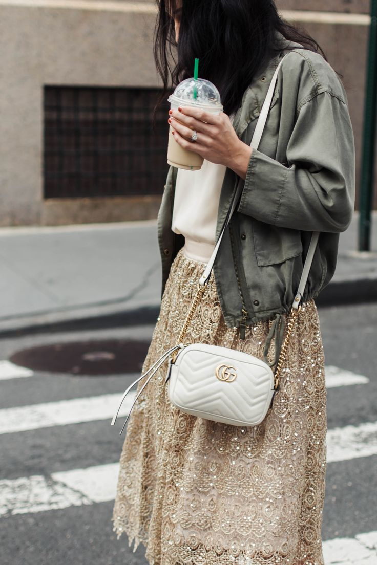 white Gucci marmont camera bag with military jacket