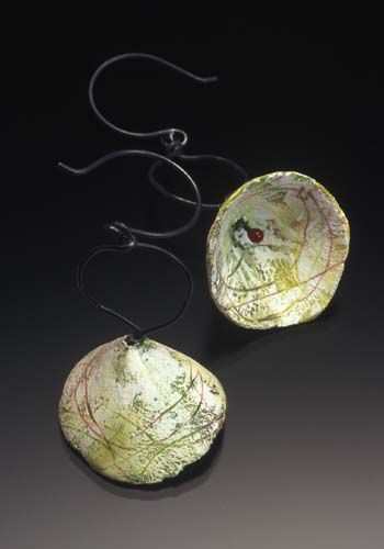 Jennifer Hall: Earrings in sterling silver, copper, paper, paint, colored pencil and epoxy resin.
