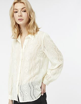 Z2018  Our Josefine broderie blouse puts an ultra-feminine spin on this season's shirting. Designed with wavy cut-outs and floral embroidery, this button up feature...