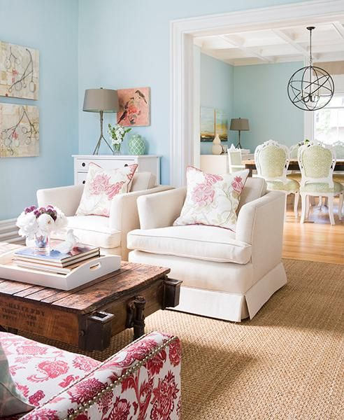 living rooms - turquoise aqua blue walls Great Colors for Girl's Toy Room. paint color jute living rug white armchairs rustic wagon coffee table nailhead trim pink chair branch lamp My to-be bedroom color! ----office idea?