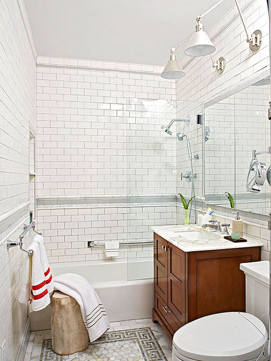 Bathroom decorations with tones of white, off-white, and tan create a calming feel in this small bath.