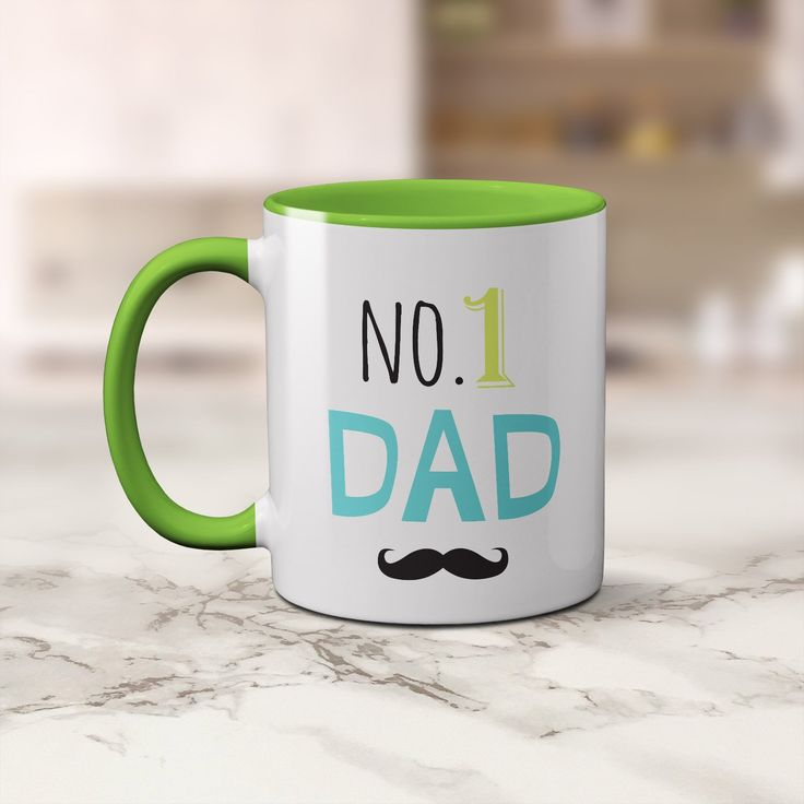 A bright coffee mug for Dad with the artwork No. 1 Dad with a black moustache perfect for Father's Day or for his birthday.  This is a 11oz white coffee cup with a gorgeous green handle and it is also green along the rim and inside.  A fun mug for dad's that love coffee.