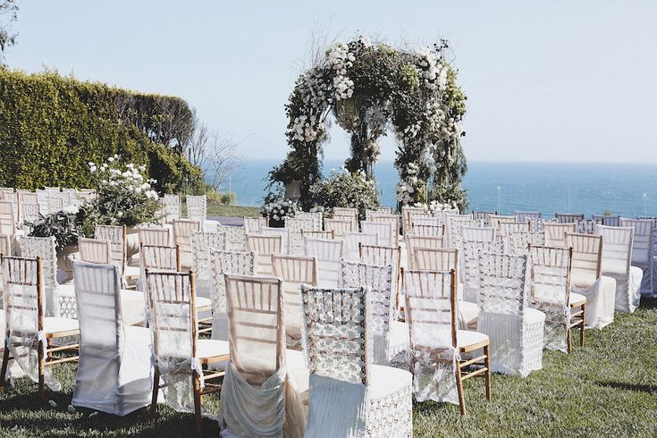 Lace Slipcovers on Wooden Chairs at Cliffside Ceremony | Photography: Daniel Kincaid Photography. Read More: http://www.insideweddings.com/weddings/brittney-palmer-and-aaron-zalewski/595/