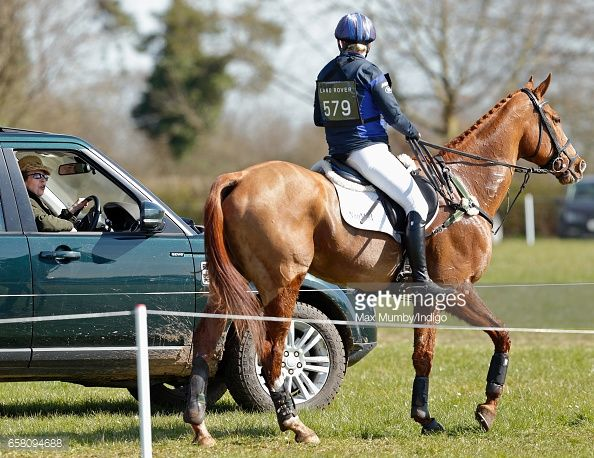Princess Anne, The Princess Royal talks with Zara Phillips after she competed the cross country phase of the Gatcombe Horse Trials at Gatcombe Park on March 26, 2017 in Stroud, England.
