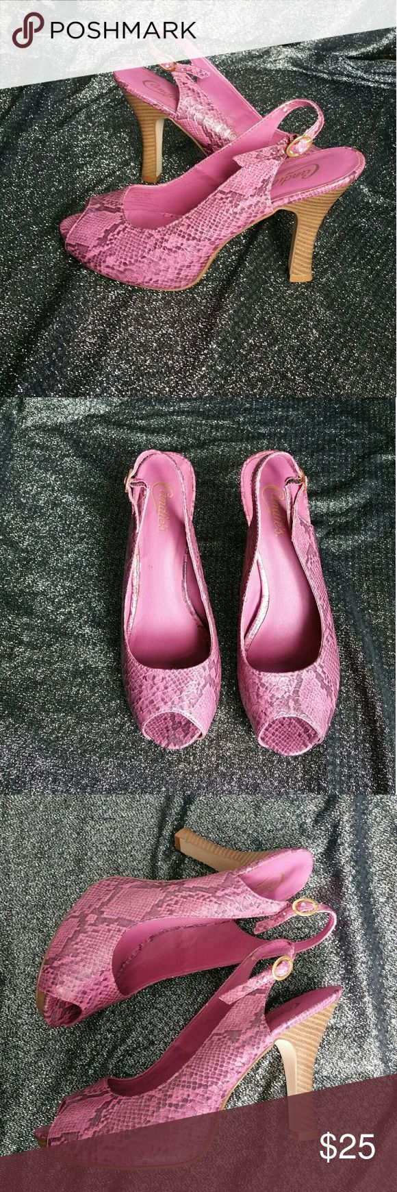 """Candies Peep Toe Snake Print Purple Heels, Size 9 These are **LIKE NEW** open toe, slingback, high heels by Candie's. The model is called """"Prittie Print"""".  They are faux snake skin print.  The pictures look more pink but the last picture shows the true color, which is more purple.  There is also gold glitter in the print too, which is hard to see in the photos. Pix don't do these heels justice!   1 inch platform at thickest part, 1/2 inch at toe. 4 1/2 inch heel. Size 9. Medium Width…"""