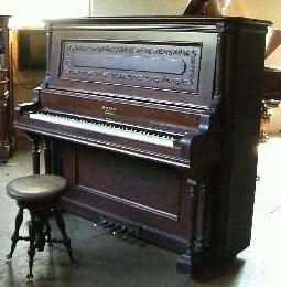 """This is a very nice Wing & Son 5 pedal orchestral upright grand piano in beautiful French Walnut. According to its original turn-of-the-century sales catalog advertisement (see photos), this piano was sold as the 'Style 23 Concert Grand'. """