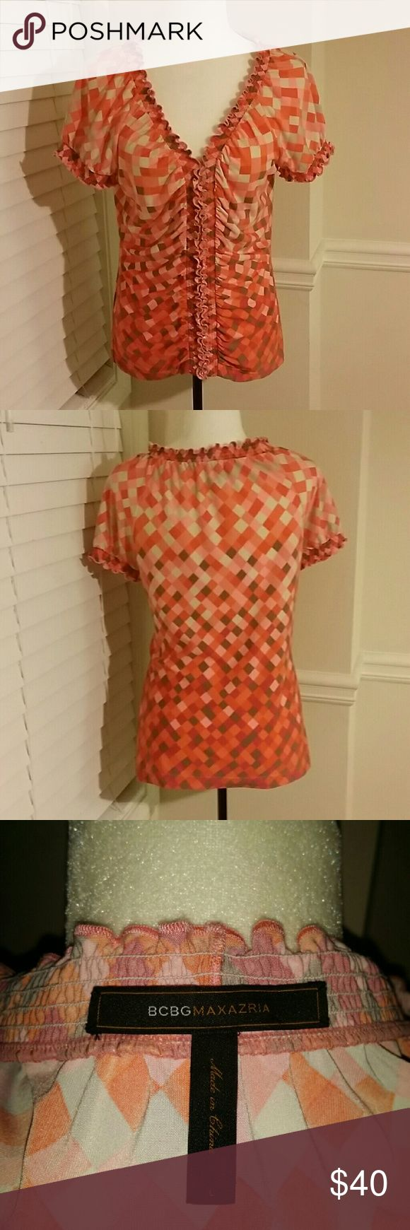 BCBGMAXAZRIA Top Fabric is 94% polyester and 6% spandex.  Various shades of orange, pink, tan/taupe and white. BCBGMaxAzria Tops