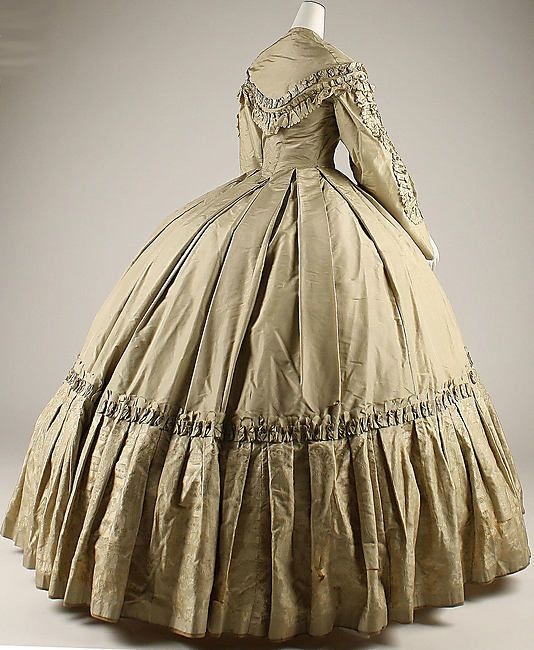 Back of dress pinned nearby. This very full skirt would have been achieved with the use of a cage crinoline below, a wire contraption women of my novel's timeframe (1853-4) were luckily not yet subjected to.